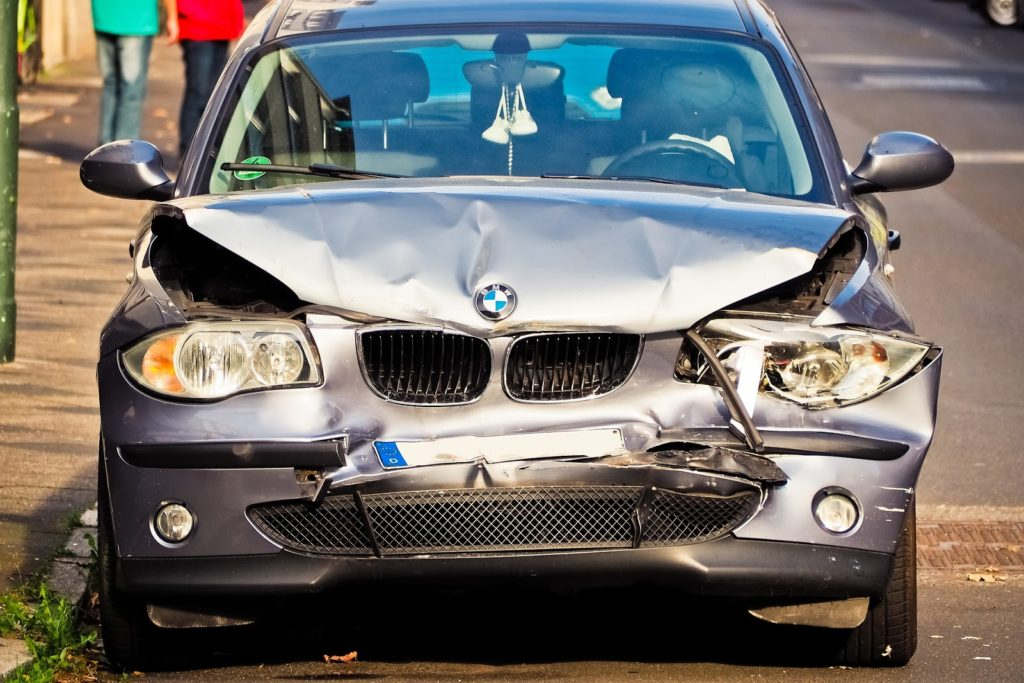 front of a car that has been damaged in an accident.
