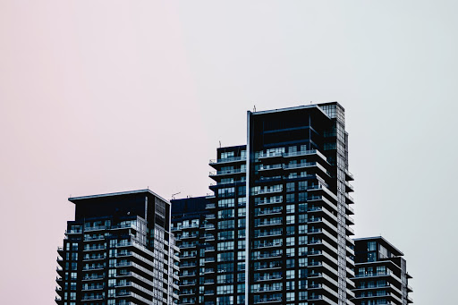 Cluster of condo buildings against a grey sky.