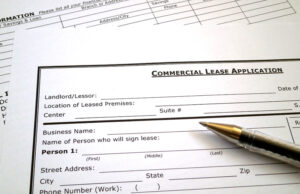 Pen resting on commercial lease documents.